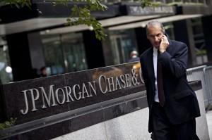 Man walks past JP Morgan Chase's international headquarters on Park Avenue in New York
