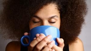 Woman-enjoying-a-cup-of-coffee-via-Shutterstock-615x345